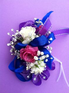 Corsage of royal blues and purples with white accents.