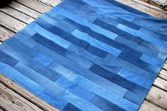 Strip denim blanket...the reason that I have three garbage bags full of holey jeans.