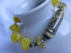 Lemon yellow handmade glass bead bracelet with mix of vintage and contemporary beads by Trudysbeads on Etsy