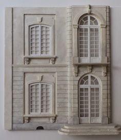 La façade avant est presque terminée, il reste à faire les parements sur le côté. Ils iront jusqu'en haut. Il y a encore des petits détails...