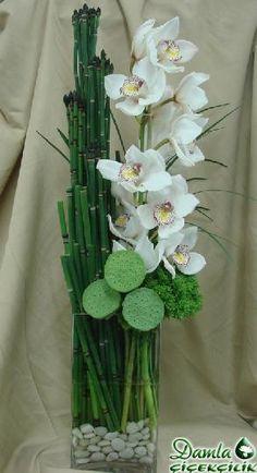 Bamboo and orchid arrangement in a vase  - Damla Çiçekcilik - Gayrettepe Çiçekcilik