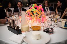 "For dessert, each guest was served a miniature ""blank canvas"" birthday cake sided with toppings in test tubes and beakers. The toppings included lime curd, mango sauce, mixed berries, and sprinkles.   Photo: Mysi Anne Grubbe for Jeremy Lawson Photography"