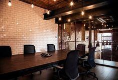 Beautiful white tile wall, exposed metal beams, large/dark wood floors, and edison bulbs...