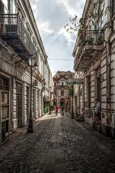 """This is a cobblestone street in the """"Old City"""" part of Bucharest, Romania. Oh The Places You'll Go, Places To Visit, Romania Travel, Little Paris, Bucharest Romania, Destination Voyage, Old City, Adventure Is Out There, Wonderful Places"""