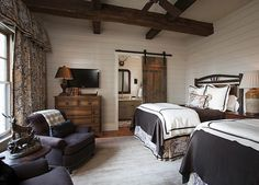 planked walls, curtains, beams, charcoal chairs, sliding wood door