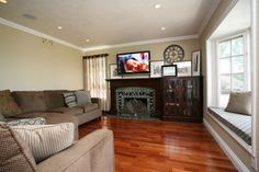 Pacific Coast Custom Design.  Beautiful craftsman fireplace surround made of maple in a rich walnut finish.