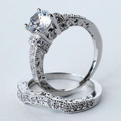 This is a gorgeous 3.2ct Brilliant cut engagement ring set with matching band.    Quick note about the pictures before I tell you more about the