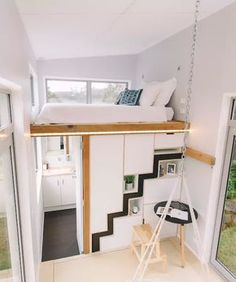 This modern home has large double glazed windows, a retractable staircase, and a large storage compartment under the living room floor.