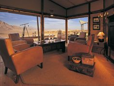 Set in breathtaking landscape atop flame red sand dunes, Wolwedans Dunes Lodge's 9 comfortable wooden chalets offer a perfect setting in which to relax, reflect and immerse yourself in the desert. Sleeping Under The Stars, Luxury Camping, The Dunes, Old World Charm, Throughout The World, Lodges, Hotel Reviews, Swimming Pools, Houses