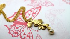 Triple Gold Orchid & Cream Pearl Pendant By by twinklejewellery, £14.00