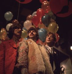 30th June 1967: George Harrison (1943 - 2001), Ringo Starr and John Lennon (1940 - 1980) of the Beatles, at the EMI studios in Abbey Road, as they prepare for 'Our World', a world-wide live television show broadcasting to 24 countries with a potential audience of 400 million. (Photo by John Williams/BIPs/Getty Images)