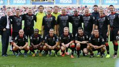 (L-R back row) coach Eric Harrison, Gary Neville,  Robbie Savage, Dutch former goalkeeper Raimond van der Gouw, John O'Kane,  Polish goalkeeper Tomasz Kuszczak, Mikael Silvestre, Quinton Fortune, David May, former cricketer Steve Harmison,  Phil Neville and former cricketer Michael Vaughan, (L-R front row),  Nicky Butt, Raphael Burke, Ryan Giggs, Paul Scholes, comedian Jack Whitehall and Ben Thornley
