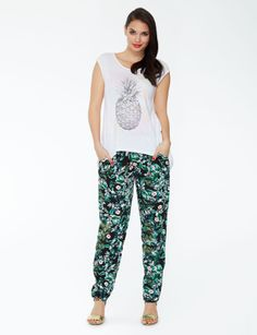 Stay comfy and stylish in these tropical printed jogger pants. They have front pockets and an elastic tie.