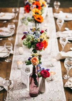 grace your wooden table with a little lace | see more creative table runners here: http://www.mywedding.com/articles/creative-wedding-table-runners/