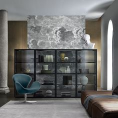 middle room Alambra cabinet with black aluminum frame, doors and shelves in transparent gray glass, equipped with integrated LED lighting system.