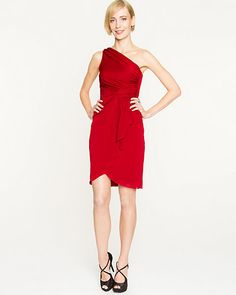 A dress that evokes old Hollywood glamour with its layered hem and one-shoulder design.