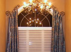 Pretty arched window drapery solution by Drapery Design.  Metropolis Iron can make any style window hardware like this.  www.metroiron.net