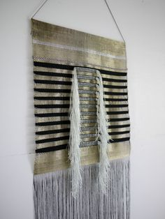 Serpentine woven gold by Justine Ashbee for Native Line. NativeLine by Justine Ashbee woven gold textile wall art piece, woven wall hanging, metallic threads. Http://Nativeline.com