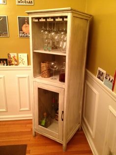 Liquor Cabinet. maybe a corner cabinet instead but with chicken wire on the bottom cabinet door. :)