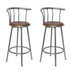 A set of trendy bar stools made of MDF and steel in a stylish design, perfect at the bar counter or in your living room. The seat of the bar stool can swivel 360 degrees and is made of brown MDF. Each stool features a footrest design so that you can sit comfortably all evening. The bar stools are easy to assemble and clean when necessary. Colour: Brown Material: Steel Material of seat: MDF Dimensions: 40 x 40 x 99 cm (W x D x H) Seat height: 75 cm Delivery includes 2 stools Max. loading capacity Wooden Swivel Bar Stools, Bar Stools Uk, Bar Stools For Sale, Bar Stools With Backs, Metal Bar Stools, Table Stools, Stool Chair, Kitchen Counter Chairs, Kitchen Breakfast Bar Stools