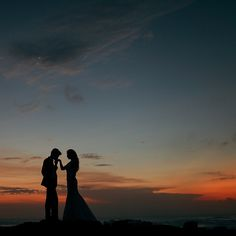 Stunning sunrise with silhouettes of the engaged couple // Following their dramatic ballroom wedding and gritty day-after-wedding photo shoot, Joshua and Cheryl are back to steam up our screens with a pre-wedding in Bali captured by Gustu of Maxtu Photography. Whether at a volcano, lake, waterfall, beach or cliffs, the connection Joshua and Cheryl share is palpable.