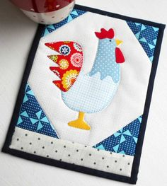 *** PDF PATTERN for IMMEDIATE DOWNLOAD *** In Eastern culture roosters are regarded as always looking good and of being honest and true. And so it is with this fun and functional mug rug design from the Patchsmith. Created using a combination of simple patchwork and quick-fuse applique this project is suitable for beginner and experienced quilters alike. The pattern includes easy-to-follow instructions, colour diagrams and full size applique sheets leaving you with the hardest part –…