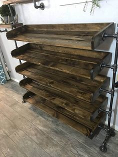 Handcrafted, industrial pipe shoe rack. This shoe rack is assembled with black steel pipe and wood. The wood on it has been sanded until smooth, but left with is rustic characteristics. The shoe rack shown has been finished in Early American. It can also be painted, custom-color stained or left natural. This shoe shelf will add the perfect accent to your closet, mudroom or entryway! The first rack shown is the 4 tier - 36 model and has been finished in Early American. It holds approximately…