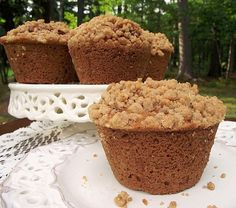 Crumb Topped Caramel Zucchini Muffins with a swirl of Dulce de Leche hiding inside and a buttery, crunchy crumb topping.