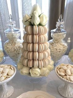 Incredible macaron tower at a white wedding party! See more party planning ideas at CatchMyParty.com!