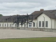 Dachau today with the memorial to imprisoned people reflecting the starved people hanging in the electric fence