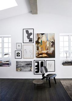 Mix different art medium and sizes of work grouped together for a more eclectic vibe. Keep all work hung above and below one horizontal line as shown here.