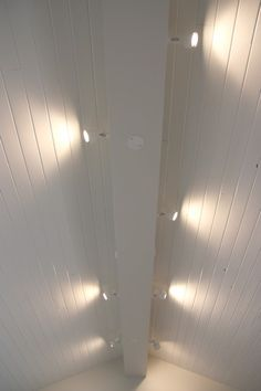 Add track lighting to center ceiling beam and boxes for future fans