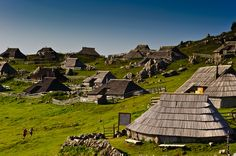 Velika Planina (literally 'Great Pasture') is dispersed high-altitude settlement of mostly herders' dwellings on a mountain plateau in the Kamnik Alps, Slovenia.    The mainly wooden huts and barns in the settlement have a particular architecture. They are single-room dwellings with shingled oval roofs extending nearly to ground level, making the space created by the extended roof suitable for sheltering livestock. There are very few permanent residents in the settlement, but in the summer m...