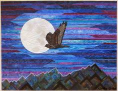Strip pieced landscape quilt with hawk, moon and mountains. Night Hunter by Cathy Geier