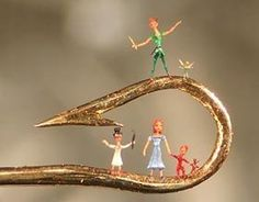 snopes.com: Willard Wigen - Microscopic Art --Peter Pan and Tinkerbell etc on a small fishhook      Willard makes sculptures out of dust particles,  sugar crystals,  etc. Works only around Midnight and can do some of the work only in between heartbeats.