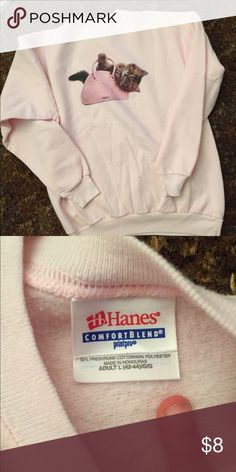 Cute Hanes Cat Purse Sweatshirt Like new not worn. Great and so cute to stock up your winter wardrobe. Only selling because it's too big for me. Cute shirt for a cat lover!  ✅Bundle discount, reasonable offers, trades on items below $10, short term holds, and free gift with purchase. Feel free to ask questions before you purchase! 🚫low ball offers, rude people , or long term holds Hanes Tops Sweatshirts & Hoodies