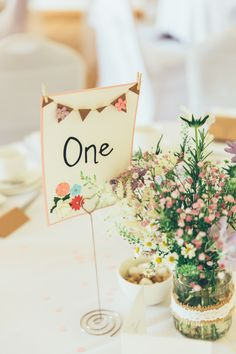 Beautiful Bunting Wedding Table Numbers. Kraft paper with bunting and pastel colours, perfect for a vintage themed wedding. Part of the 'BEAUTIFUL BUNTING' collection by Paper Date. Photography: Francesca Hill Photography