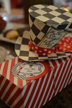 Queen of Hearts themed party - custom made MAD HATTER top hats. Hot glued a hair clip to each so that lady guests can where them.