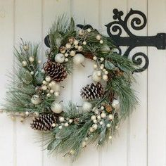 A luxury Spiky Blue Fir LED Wreath by Gisela Graham with impressive blue fir, frosted pine cones and gittering berries to complete a festive wreath that will be a popular addition to your Christmas decorations for many years.