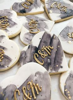 Wedding custom sugar cookies; watercolor background with gold piped initials