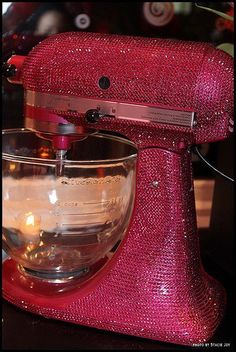 Even though I dont bake..anything pink, has crystals, and is over the top is my shit so I must say I need this lol..