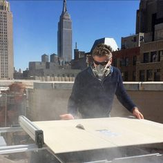 Getting ready for the show from my sudio balcony in NYC – cutting cement board panels to mount mosaic samples on.