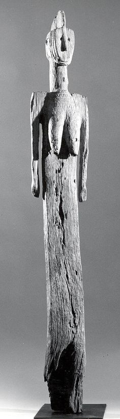 Protective Post: Female Figure  Date: 19th–20th century Geography: Burkina Faso Culture: Mossi peoples Medium: Wood Dimensions: H. 51 3/4 x W. 7 1/2 x D. 4 in. (131.4 x 19.1 x 10.2 cm)