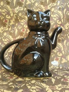 """cat teapot, on the hunt for a dog teapot like my grandmother's, it was functional--kitty is 7.25"""" tall, body approx 4"""" wide, including handle and spout approx 7.5"""" wide and her is very cute"""