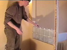 How to Install Glass Blocks. Glass blocks, or glass bricks, are both functional and decorative. They provide added lighting while still maintaining privacy. Glass blocks can serve many purposes, like creating a room divider, surrounding a. Glass Blocks Wall, Glass Block Windows, Block Wall, Glass Walls, Glass Block Installation, Demis Murs, Glass Block Shower, Window In Shower, Glass Brick