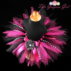 The Diva Party birthday tutu is stunning in black and fuchsia tulle and polka dot ribbons . kinda misterious. no one will ever forget this tutu.