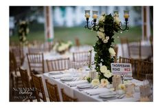 Wedding centerpiece candelabras with vines and white roses Chris & Siena's Wedding in The Berkshires | Kemble Inn | Lenox, MA