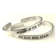 """This Game of Thrones inspired aluminum bracelet set is hand stamped with """"My Sun and Stars"""" on one and """"Moon of My Life"""" on the other. Each bracelet measures 6"""" x 1/4"""". The bracelets are made out of P"""