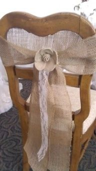 Old chairs with lace and ribbon for seating