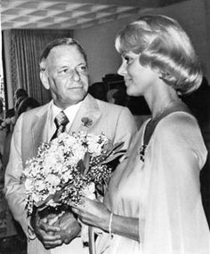 Frank Sinatra and bride, the former Barbara Marx, who were wed July 11 1976, at the home of Walter Annenberg, former US Ambassador to Britain.  The couple cut a four-tiered wedding cake at reception. The singer's gift to his bride was a $100,000 Rolls Royce.